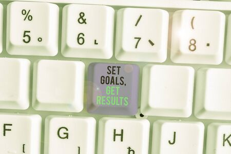 Writing note showing Set Goals, Get Results. Business concept for Establish objectives work for accomplish them
