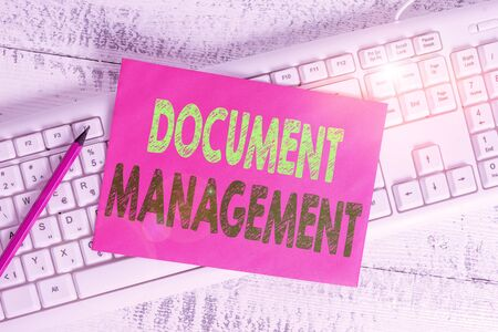 Handwriting text writing Document Management. Conceptual photo Computerized analysisagement of electronic documents White keyboard office supplies empty rectangle shaped paper reminder wood Banque d'images