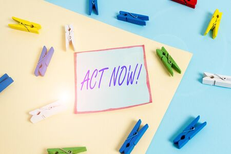 Word writing text Act Now. Business photo showcasing fulfil the function or serve the purpose of Take action Do something Colored clothespin paper empty reminder yellow blue floor background office