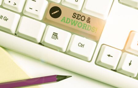 Handwriting text Seo And Adwords. Conceptual photo they are main tools components of Search Engine Marketing Stock Photo