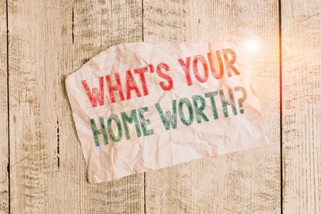 Text sign showing What s Your Home Worth question. Business photo showcasing Value of a house Property Cost Price Rate Crumpled torn paper half broken placed above classic wooden background Stock fotó