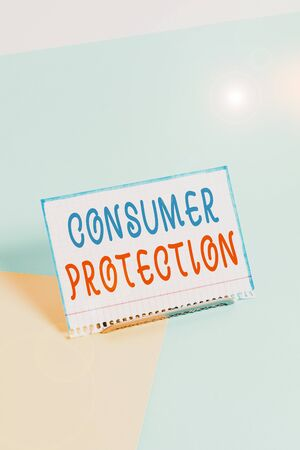 Text sign showing Consumer Protection. Business photo showcasing regulation that aim to protect the rights of consumers Paper placed tilted above buffer wire on soft pastel multi colours backdrop Reklamní fotografie