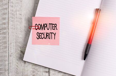 Word writing text Computer Security. Business photo showcasing protection of computer systems from theft or damage Thick pages notebook stationary placed above classic look wooden backdrop