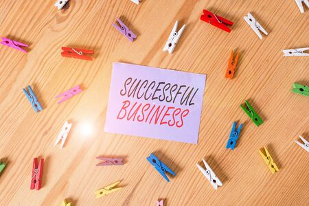Text sign showing Successful Business. Business photo showcasing Achievement of goals within a specified period of time Colored clothespin papers empty reminder wooden floor background office