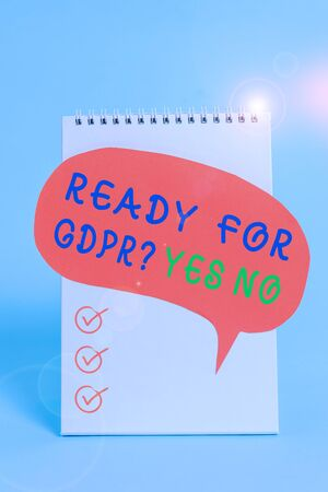 Word writing text Ready For Gdpr question Yes No. Business photo showcasing Readiness General Data Protection Regulation Standing blank spiral notepad speech bubble lying cool pastel background