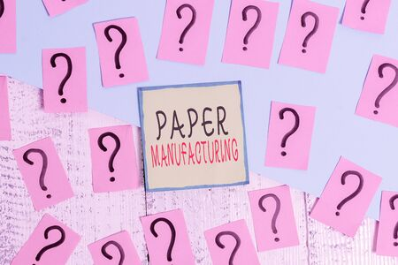 Handwriting text writing Paper Manufacturing. Conceptual photo company that use wood as raw material and produce paper Scribbled and crumbling papers with thick cardboard above wooden table Stock Photo