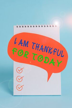 Word writing text I Am Thankful For Today. Business photo showcasing Grateful about living one more day Philosophy Standing blank spiral notepad speech bubble lying cool pastel background