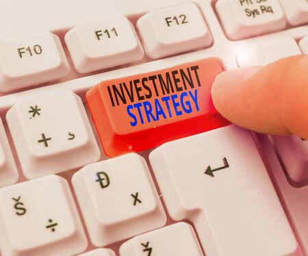 Handwriting text writing Investment Strategy. Conceptual photo the systematic plan to allocate investable assets