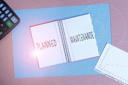 Word writing text Planned Maintenance. Business photo showcasing reventive maintenance carried out base on a fixed plan Striped paperboard notebook cardboard office study supplies chart paper 版權商用圖片