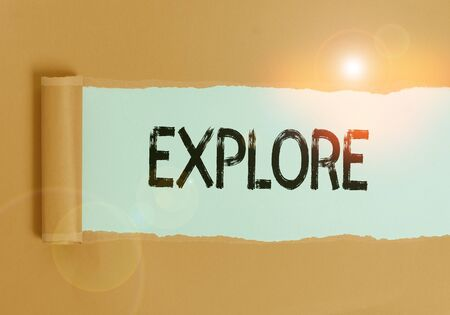 Text sign showing Explore. Business photo text Travel somewhere unknown to learn about it Examine Evaluate Cardboard which is torn in the middle placed above a plain table backdrop