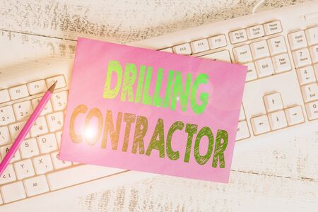 Handwriting text writing Drilling Contractor. Conceptual photo contract their services mainly for drilling wells White keyboard office supplies empty rectangle shaped paper reminder wood