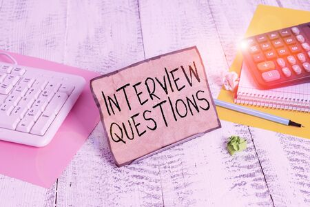 Text sign showing Interview Questions. Business photo showcasing Typical topic being ask or inquire during an interview Notepaper stand on buffer wire in between computer keyboard and math sheets