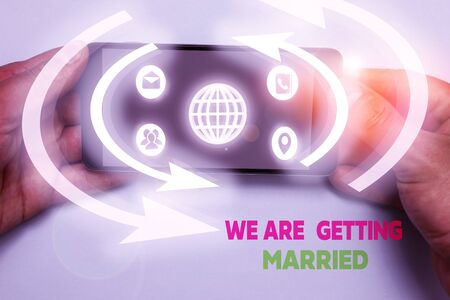 Word writing text We Are Getting Married. Business photo showcasing Engagement Wedding preparation Loving couple