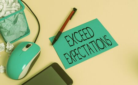Conceptual hand writing showing Exceed Expectations. Concept meaning able to surpass or beyond the acceptable perforanalysisce crumpled paper in bin placed next to modern gadget and stationary