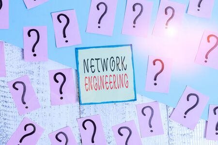 Handwriting text writing Network Engineering. Conceptual photo field concerned with internetworking service requirement Scribbled and crumbling papers with thick cardboard above wooden table