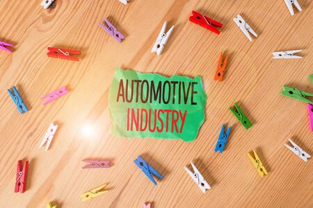 Conceptual hand writing showing Automotive Industry. Concept meaning organizations involved in the business of motor vehicles Colored crumpled papers wooden floor background clothespin