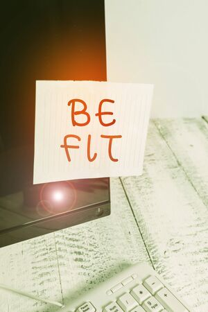 Text sign showing Be Fit. Business photo text of a suitable quality standard or type to meet the required purpose Notation paper taped to black computer monitor screen near white keyboard