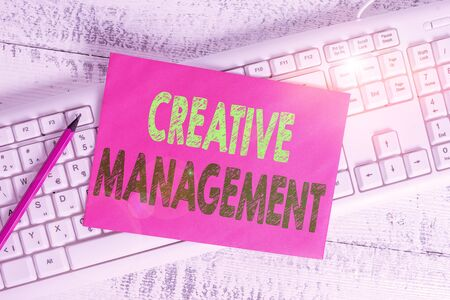 Handwriting text writing Creative Management. Conceptual photo Managing of creative thinking skills and mental process White keyboard office supplies empty rectangle shaped paper reminder wood