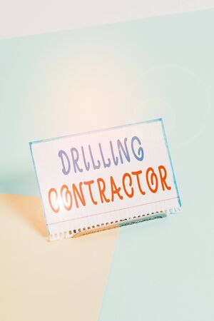 Text sign showing Drilling Contractor. Business photo showcasing contract their services mainly for drilling wells Paper placed tilted above buffer wire on soft pastel multi colours backdrop