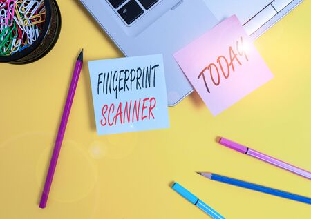 Conceptual hand writing showing Fingerprint Scanner. Concept meaning Use fingerprint for biometric validation to grant access Laptop sticky notes container pencils markers colored background