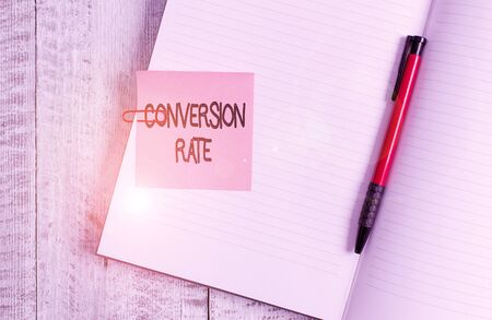 Word writing text Conversion Rate. Business photo showcasing number of visitors to a website that meet the desired goal Thick pages notebook stationary placed above classic look wooden backdrop