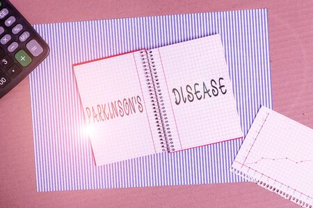 Word writing text Parkinson S Is Disease. Business photo showcasing nervous system disorder that affects movement Striped paperboard notebook cardboard office study supplies chart paper