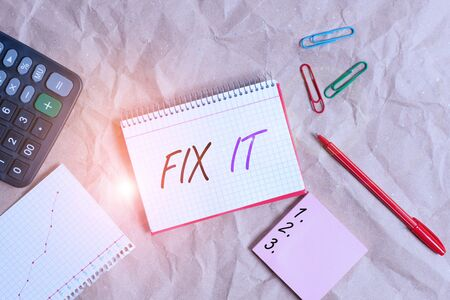 Conceptual hand writing showing Fix It. Concept meaning Fasten something securely in a particular place or position To repair Papercraft desk square spiral notebook office study supplies