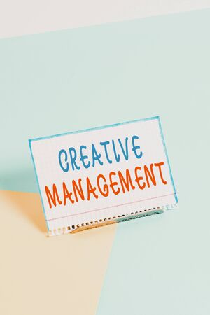 Text sign showing Creative Management. Business photo showcasing Managing of creative thinking skills and mental process Paper placed tilted above buffer wire on soft pastel multi colours backdrop