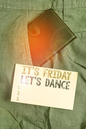 Writing note showing It s Friday Let s Dance. Business concept for Celebrate starting the weekend Go party Disco Music Small wallet inside trouser front pocket near notation paper
