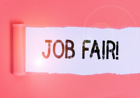 Text sign showing Job Fair. Business photo text event where employers offer information about their companies Cardboard which is torn in the middle placed above a plain table backdrop