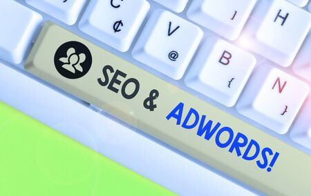 Writing note showing Seo And Adwords. Business concept for they are main tools components of Search Engine Marketing Stock Photo