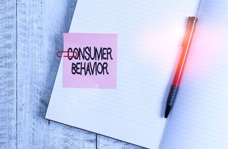 Word writing text Consumer Behavior. Business photo showcasing study of how individual customers interacts with the brand Thick pages notebook stationary placed above classic look wooden backdrop