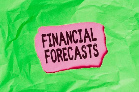 Word writing text Financial Forecasts. Business photo showcasing estimate of future financial outcomes for a company Green crumpled ripped colored paper sheet centre torn colorful background