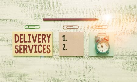 Conceptual hand writing showing Delivery Services. Concept meaning the transport of items between two or more parties Blank notepads marker small alarm clock wooden vintage background