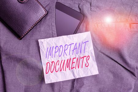 Text sign showing Important Documents. Business photo text more official pieces of paper with writing on them Smartphone device inside trousers front pocket with wallet and note paper