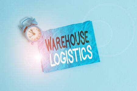 Conceptual hand writing showing Warehouse Logistics. Concept meaning flow of both physical goods and information in business Metal vintage alarm clock crush sheet sky colored background