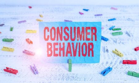 Word writing text Consumer Behavior. Business photo showcasing study of how individual customers interacts with the brand Green clothespin white wood background colored paper reminder office supply