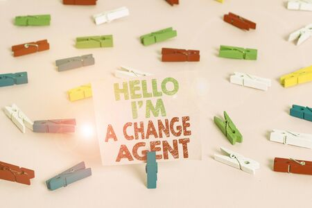 Text sign showing Hello I am A Change Agent. Business photo showcasing Promoting and enabling difference evolution new Colored clothespin papers empty reminder pink floor background office pin