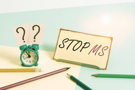 Handwriting text Stop Ms. Conceptual photo treat the condition that can affect the brain and spinal cord Mini size alarm clock beside stationary placed tilted on pastel backdrop 版權商用圖片