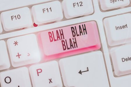 Writing note showing Blah Blah Blah. Business concept for Talking too much false information gossips nonsense speaking Keyboard with note paper on white background key copy space 版權商用圖片
