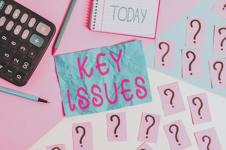Handwriting text writing Key Issues. Conceptual photo vital or unsettled matter that showing are arguing about Mathematics stuff and writing equipment above pastel colours background Stock fotó