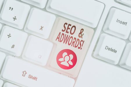 Conceptual hand writing showing Seo And Adwords. Concept meaning they are main tools components of Search Engine Marketing White pc keyboard with note paper above the white background
