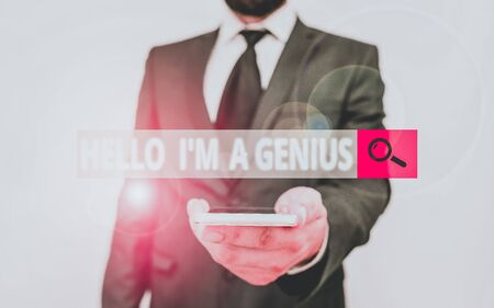 Word writing text Hello I M A Genius. Business photo showcasing Introduce yourself as over average demonstrating to others Male human wear formal work suit hold smart hi tech smartphone use one hand