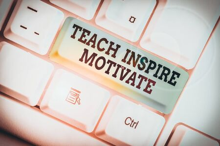 Handwriting text writing Teach Inspire Motivate. Conceptual photo Spark the Imagination to Feel the need to Learn White pc keyboard with empty note paper above white background key copy space Zdjęcie Seryjne