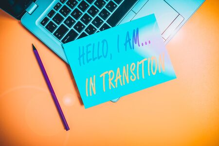 Conceptual hand writing showing Hello I Am In Transition. Concept meaning Changing process Progressing planning new things Metallic laptop small paper sheet pencil colored background
