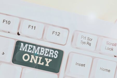 Word writing text Members Only. Business photo showcasing Limited to an individual belongs to a group or an organization White pc keyboard with empty note paper above white background key copy space