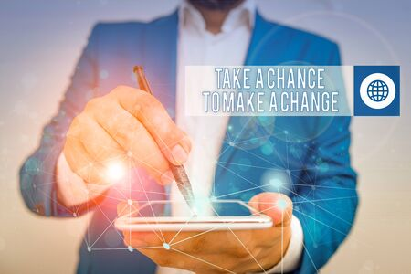 Conceptual hand writing showing Take A Chance To Make A Change. Concept meaning dont lose opportunity to reach bigger things Male human wear formal suit presenting using smart device