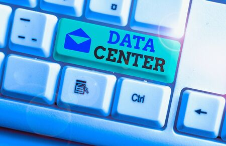 Handwriting text Data Center. Conceptual photo a repository that houses computing facilities like servers White pc keyboard with empty note paper above white background key copy space