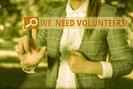 Handwriting text We Need Volunteers. Conceptual photo someone who does work without being paid for it Business woman in the nature pointing with the finger into empty space