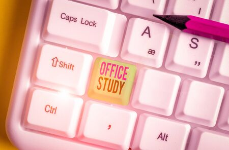 Text sign showing Office Study. Business photo showcasing any location or venue where a demonstrating s is work is performed White pc keyboard with empty note paper above white background key copy space Banco de Imagens